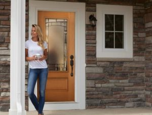 Cornerstone windows - woman standing in front of entry front doors masonite